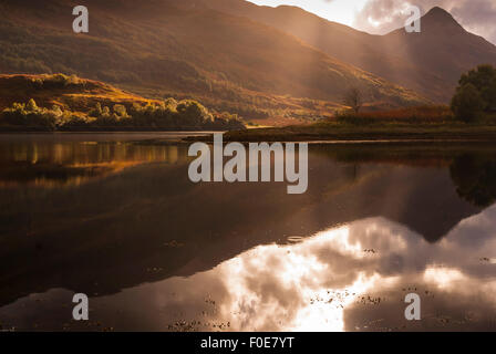 Evening light across Loch Leven looking towards a Pap of Glencoe, Sgorr na cinche, lochaber, Scotland. - Stock Photo