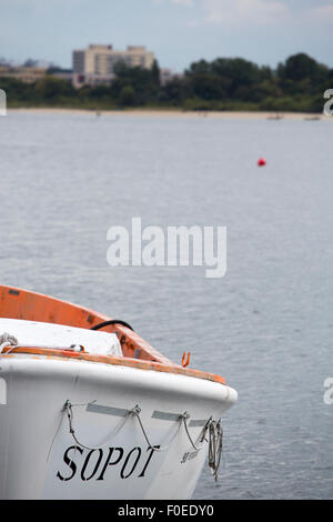 Detail of a safety boat in the marina of Sopot on the Baltic Sea. The name of the city Sopot is written on the boat. - Stock Photo
