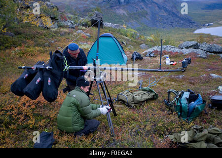Camera crew from Gulo films setting up crane for filming, Sarek National Park, Laponia World Heritage Site, Lapland, - Stock Photo