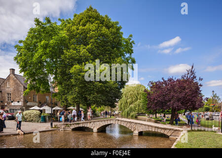 A summer afternoon in the Cotswold village of Bourton-on-the-Water, Gloucestershire, England. - Stock Photo