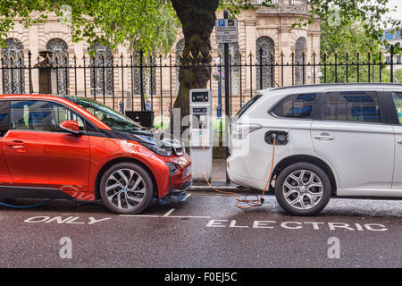 Electric cars being charged in the centre of Birmingham, West Midlands, England - Stock Photo