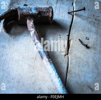 Nail sticking out after being hammered - Stock Photo