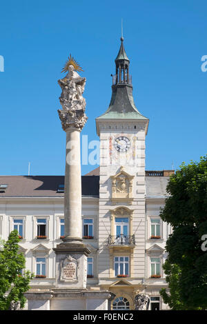 Holy Trinity Column on the main square in front of the city hall, Mistelbach, Weinviertel, Lower Austria, Austria - Stock Photo