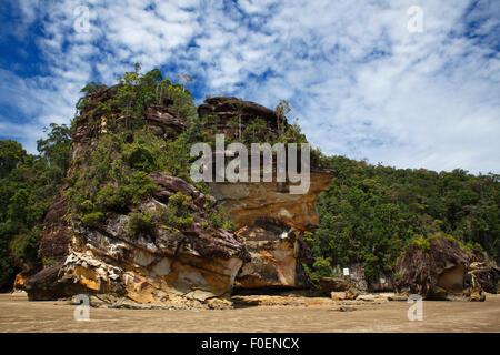 Bako National Park, sandstone rock and rainforest on the coast, South China Sea, Sarawak, Borneo, Malaysia - Stock Photo