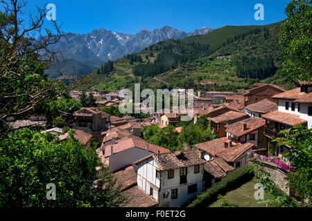 Rooftops of Potes with Picos de Europa behind,Asturias,Northern Spain - Stock Photo