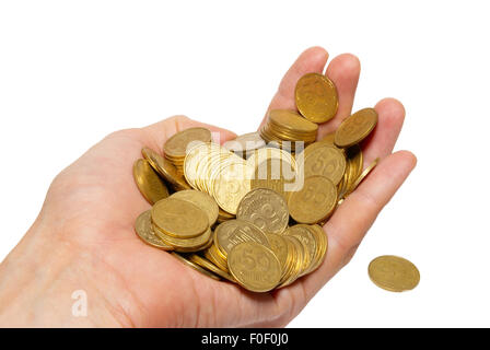 Many coins in a hand isolated on white. - Stock Photo