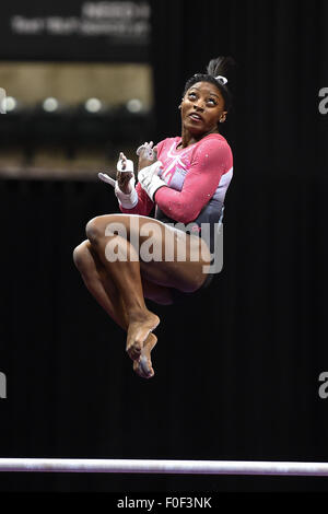Aug. 13, 2015 - Indianapolis, Indiana, U.S - World Champion SIMONE BILES dismounts from the uneven bars as she finished - Stock Photo