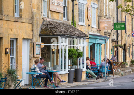 Relaxing in Stow on the Wold, Gloucestershire, England, UK - Stock Photo