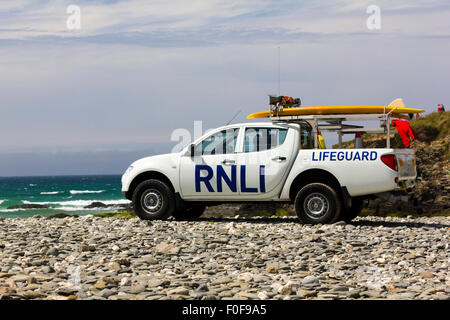 Fully Equipped RNLI Lifeguard Patrol Vehicle Parked on Gwithian Beach, Saint Ives Bay, Cornwall. - Stock Photo