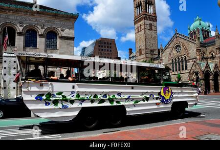 Boston, Massachusetts: A Boston Duck Tours bus/boat filled with tourists in Copley Square - Stock Photo