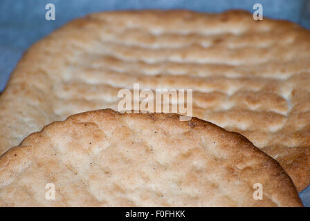 Traditional fresh Greek pita taken from the oven closeup. - Stock Photo