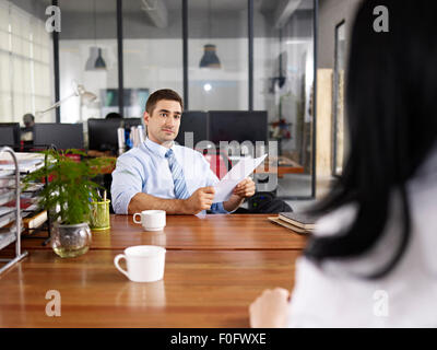 caucasian HR manager conducting an interview - Stock Photo