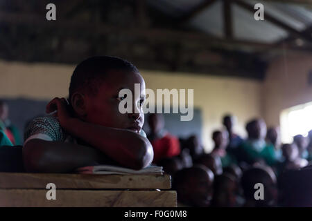 Young students attending class Olesere primary school Rift Valley Kenya Africa - Stock Photo