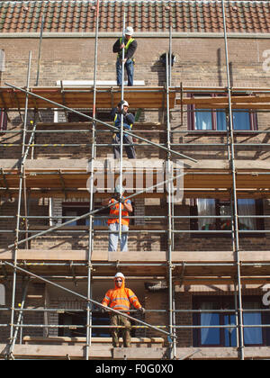 Newcastle Upon Tyne, 15th August 2015, UK Weather. Scaffolders in the process of dismantling a spiders web of steel - Stock Photo