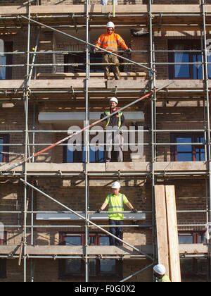 Newcastle Upon Tyne, 15th August 2015, UK Weather. Scaffolders in the process of dismantling a spiders wed of steel - Stock Photo