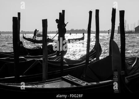 Parked gondola boats in Venice, Italy - Stock Photo