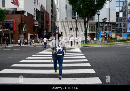 Thai women walk cross over road at crosswalk go to Dotonbori on July 7, 2015 in Osaka, Japan - Stock Photo
