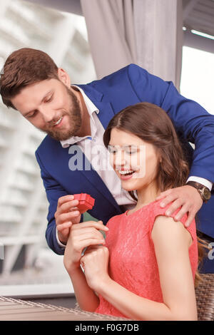 Man doing proposal to his girlfriend - Stock Photo