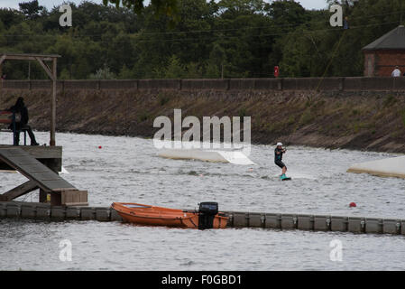 A young Girl Cable Wakeboarding at Wakelake Chasewater Country Park lichfield, Staffordshire, UK - Stock Photo