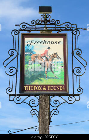 The pub sign of The Fox and Hounds Pub, Uffington, Oxfordshire, England, UK. - Stock Photo