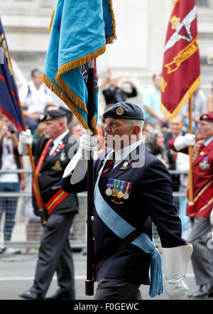 London, Britain. 15th Aug, 2015. Veterans are seen in a parade from Horse Guards Parade to Westminster Abbey after - Stock Photo