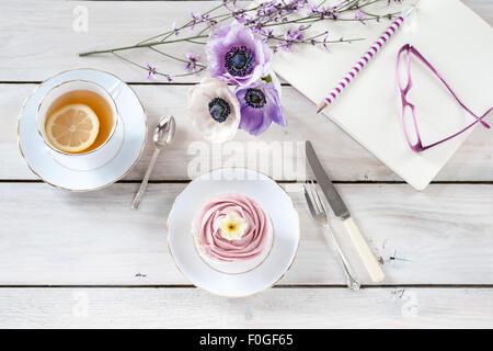 tea break with anemones and genista - Stock Photo
