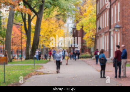 Blurred background of Harvard Yard, old heart of Harvard University campus, on a beautiful Fall day. - Stock Photo