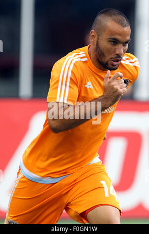 August 15, 2015; Foxborough, MA, USA; Houston Dynamo midfielder Alex (14) warms-up prior to the MLS game between - Stock Photo