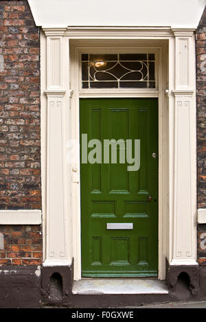 Grand Green Wooden Door, part of a home in London, England - Stock Photo