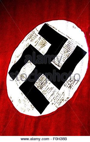 AUCKLAND -AUG 16 2015:The swastika flag  of Nazi Germany in on display in Auckland Museum.The swastika was the flag - Stock Photo