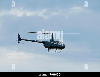 Robinson R44 Raven helicopter (G-MDDT) departing Inverness airfield Highland Scotland. SCO 10,033. - Stock Photo