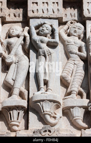 Udaipur, India. 17th century Jagdish Temple, details carved on outside wall, women musicians and dancers. - Stock Photo