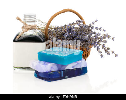 Spa still life with handmade soaps, lavender flowers and oil, on white background - Stock Photo
