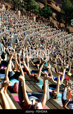Yoga practitioners, Yoga on The Rocks, Red Rocks Amphitheatre, Morrison, Colorado USA - Stock Photo