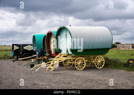 Bow top caravans temporarily camped in the car park at Boulmer in Northumberland - Stock Photo