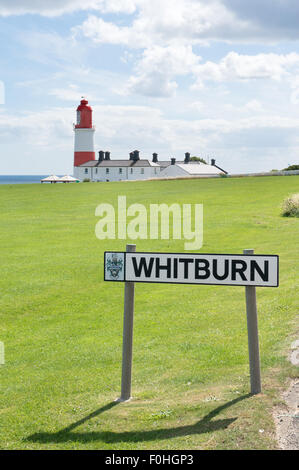 Whitburn Village sign with Souter lIghthouse in the background, Tyne and Wear, England UK - Stock Photo