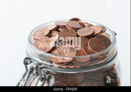 mason jar full of United States pennies - Stock Photo