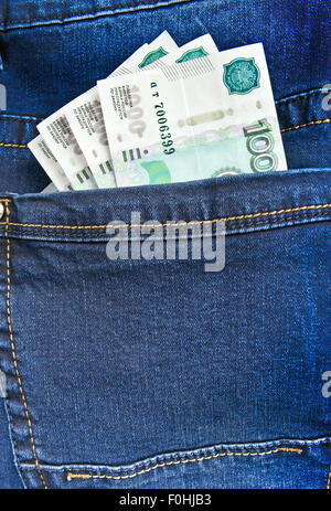 Russian money rubles in blue jeans pocket - Stock Photo