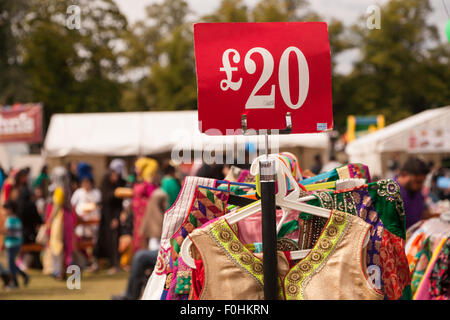 Asian Indian or Pakistani women's clothes on a rack for sale in an outdoor event, Birmingham UK - Stock Photo