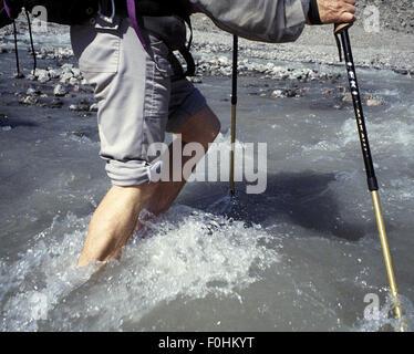 Stream Crossing on Baffin Island - Stock Photo