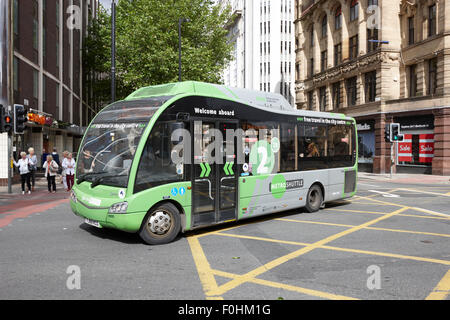 free metro shuttle bus green route two in Manchester city centre England UK - Stock Photo