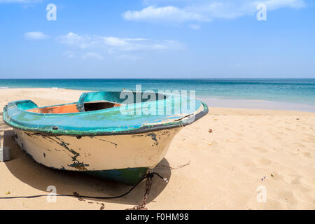 On the beach of La Perle, Guadeloupe, an old boat abandoned in the sand. The boat was viewed in tv series Death - Stock Photo