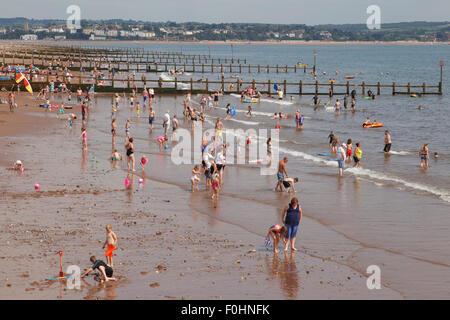 Beach holiday - crowded beach at Dawlish Warren, Devon. - Stock Photo
