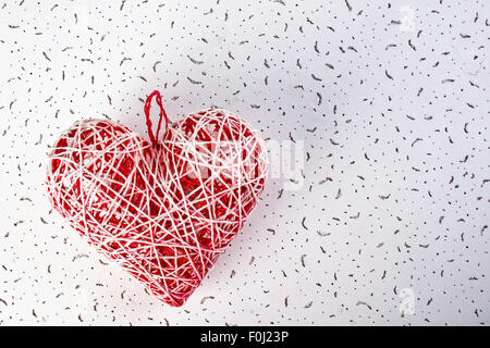 Handmade red heart of the thread. Gift for Valentine's Day. The concept of love and passion. - Stock Photo