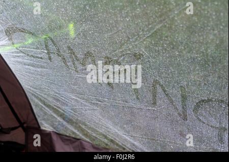 Words written in the condensation on a tent canvas. - Stock Photo & Words written in the condensation on a tent canvas Stock Photo ...
