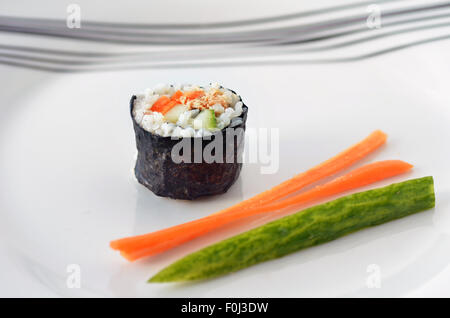One Makizushi sushi fresh maki roll, served with slice of fresh carrot and cucumber on a plate. Horizontal -with - Stock Photo