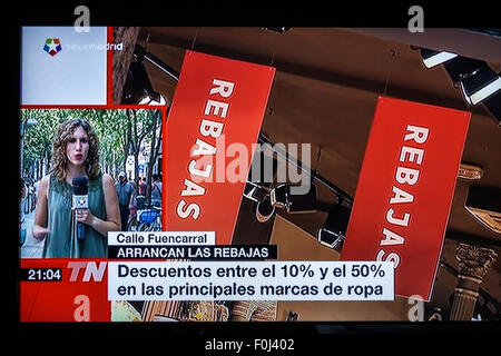 Madrid Spain Europe Spanish television TV screen media news reporting reporter summer retail sales discounts economy - Stock Photo