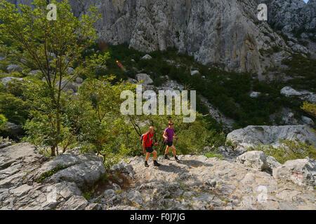Hikers in Paklenica National Park, Velebit Nature Park, Rewilding Europe area, Velebit mountains, Croatia June 2012 - Stock Photo