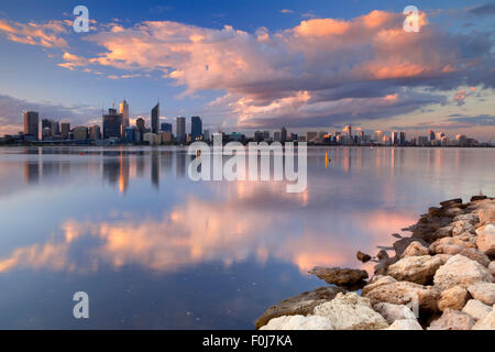 The skyline of Perth, Western Australia at sunset. Photographed from across the Swan River. - Stock Photo