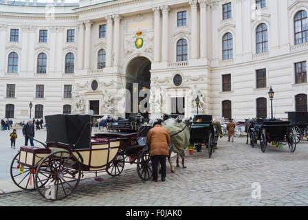 Fiakers, horse carriages, Michaelerplatz, Altstadt, old town, Vienna, Austria - Stock Photo